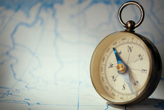 Magnetic compass standing upright on a map Stock Image