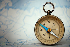 Magnetic compass standing upright on a map Stock Photo