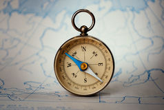 Magnetic compass standing upright on a map Royalty Free Stock Photography