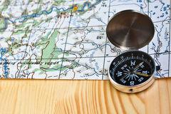 The magnetic compass and topographic map. Stock Images