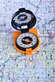 The magnetic compass and topographic map. Stock Photo
