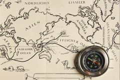 Magnetic compass with vintage map Royalty Free Stock Photos