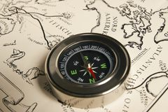 Magnetic compass with vintage map Stock Photos
