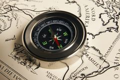 Magnetic compass with vintage map Stock Images