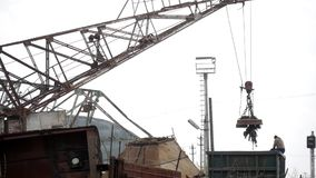Magnetic crane loading scrap metals at junkyard. Magnetic crane loading scrap metals at junkyard stock video