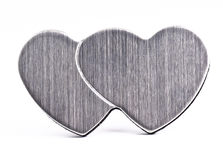 Magnetic hearts. Magnetic metal hearts, isolated on white stock photo