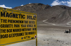 Magnetic hill sign board in Leh stock image