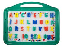 Magnetic letters on a whiteboard Stock Photos