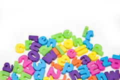Magnetic numbers and letters. An assortment of magnetic numbers and letters in bright colors Royalty Free Stock Photo