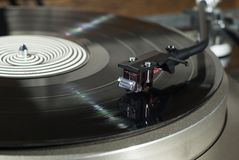Magnetic phonograph cartridge close up. Moving magnet cartridge on the tonearm standing on a vinyl record Stock Images