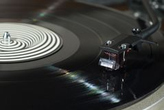 Magnetic phonograph cartridge closeup. Moving magnet cartridge on the tonearm standing on a vinyl record Stock Photography