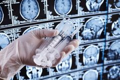 Magnetic resonance scan of the brain. MRI. Syringe in hand stock images
