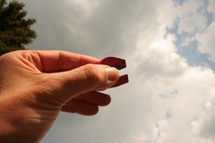 Magnetic Sky. Hand with Magnet stock photo