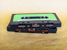 Magnetic tape cassette. For analog audio music recording, grunge authentic vintage feel stock image