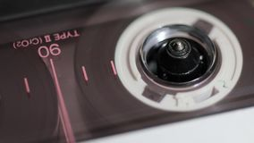 Vintage cassette closeup. Magnetic tape cassette playing closeup still footage with focus on roller stock video