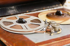 Magnetic tape with the music playing on the vintage reel tape recorder Stock Photo