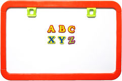 Magnetic whiteboard with alphabets, isolated Royalty Free Stock Image