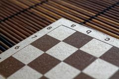 Magnetic wooden empty chessboard with white and brown cells. Magnetic wooden empty chess board with white and brown cells Stock Images