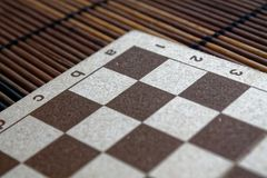 Magnetic wooden empty chessboard with white and brown cells royalty free stock photography