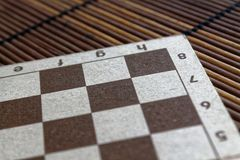 Magnetic wooden empty chessboard with white and brown cells. Magnetic wooden empty chess board with white and brown cells Royalty Free Stock Image