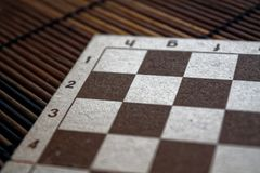 Magnetic wooden empty chessboard with white and brown cells. Magnetic wooden empty chess board with white and brown cells Royalty Free Stock Images