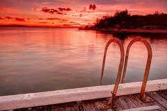 Magnetisk ö - solnedgång Arkivbild