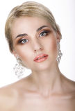 Magnetism. Portrait of Young Blond with Glossy Earrings Stock Photos