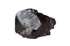 Magnetite mineral isolated. Magnetite is a mineral and one of the main iron ores, oxide, ferromagnetic, has an inverse spinel crystal structure, black color Royalty Free Stock Image