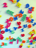 Magnetized letters and numbers on refrigerator royalty free stock photography