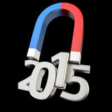 Magnetizing 2015. Magnet magnetizes the digits '2015' on black Royalty Free Stock Image