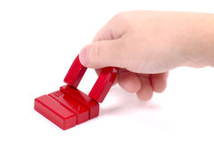 Magnets. Hand Holding a Magnet Stock Images