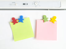 Magnets shaped kids colors with note. Paper Royalty Free Stock Photos
