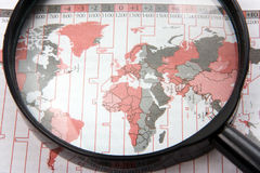 Magnifer with world map Royalty Free Stock Image