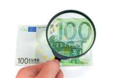 Magnification banknotes Royalty Free Stock Photo