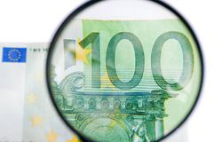 Magnification banknotes Stock Photo