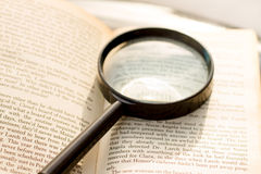 Magnification glass and book Royalty Free Stock Images