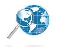 Magnification glass and world Royalty Free Stock Images