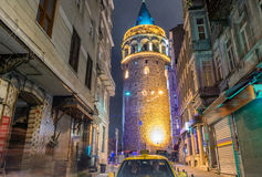 Magnificence of Galata Tower at night with taxi on the street, I Stock Images