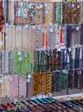 Showcase with beads made of natural materials royalty free stock photography