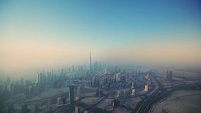 Magnificent aerial drone flight over futuristic tower skyscraper Dubai big city in morning sunrise. Aerial drone flight over futuristic tower skyscraper Dubai stock footage