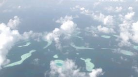 Magnificent aerial helicopter flyover white fluffy clouds in sky over wild nature turquoise lake green tropical forest. Fascinating aerial helicopter flyover stock video