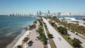 Magnificent aerial 4k drone panorama flight over huge highway road in big city Miami East Coast ocean coastline seascape stock video footage