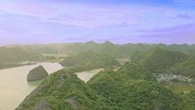 Aerial View Small Islands Spread in Ocean under Blue Sky. Magnificent aerial view hilly small islands spread in beautiful ocean under pictorial blue sky stock video footage