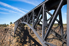 Magnificent arched tracery transport bridge in deserted rocky la Stock Images