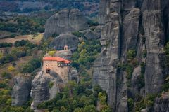 Magnificent autumn landscape.Meteora Monasteries Holy Monastery of St. Nicholas Anapausas on the top of rock near Kalambaka Royalty Free Stock Images
