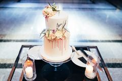 Magnificent bisexual cake for brides and guests.  royalty free stock image