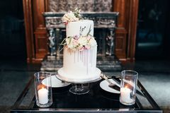 Magnificent bisexual cake for brides and guests.  stock photography