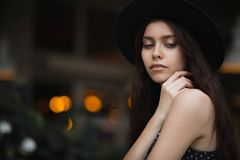 Magnificent brunette girl wearing hat and vintage dress posing a stock images
