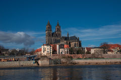 Magnificent Cathedral of Magdeburg at river Elbe with blue sky, Stock Photo