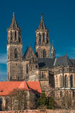 Magnificent Cathedral of Magdeburg at river Elbe with blue sky, Stock Images